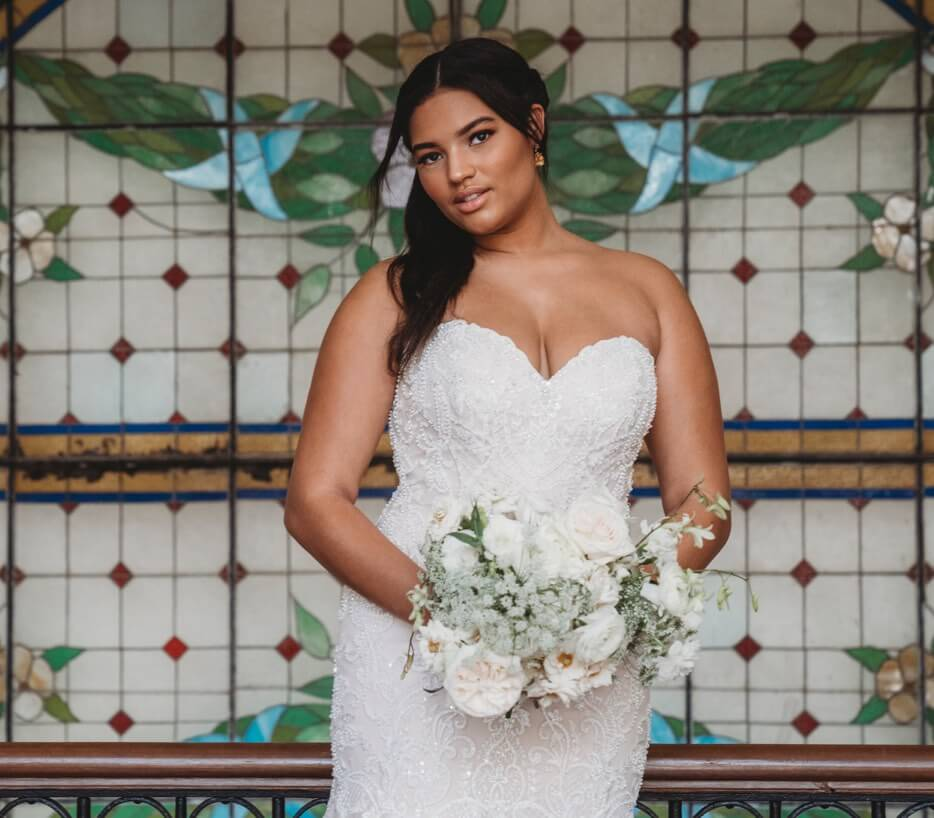Photo of a plus-size bride in a white gown