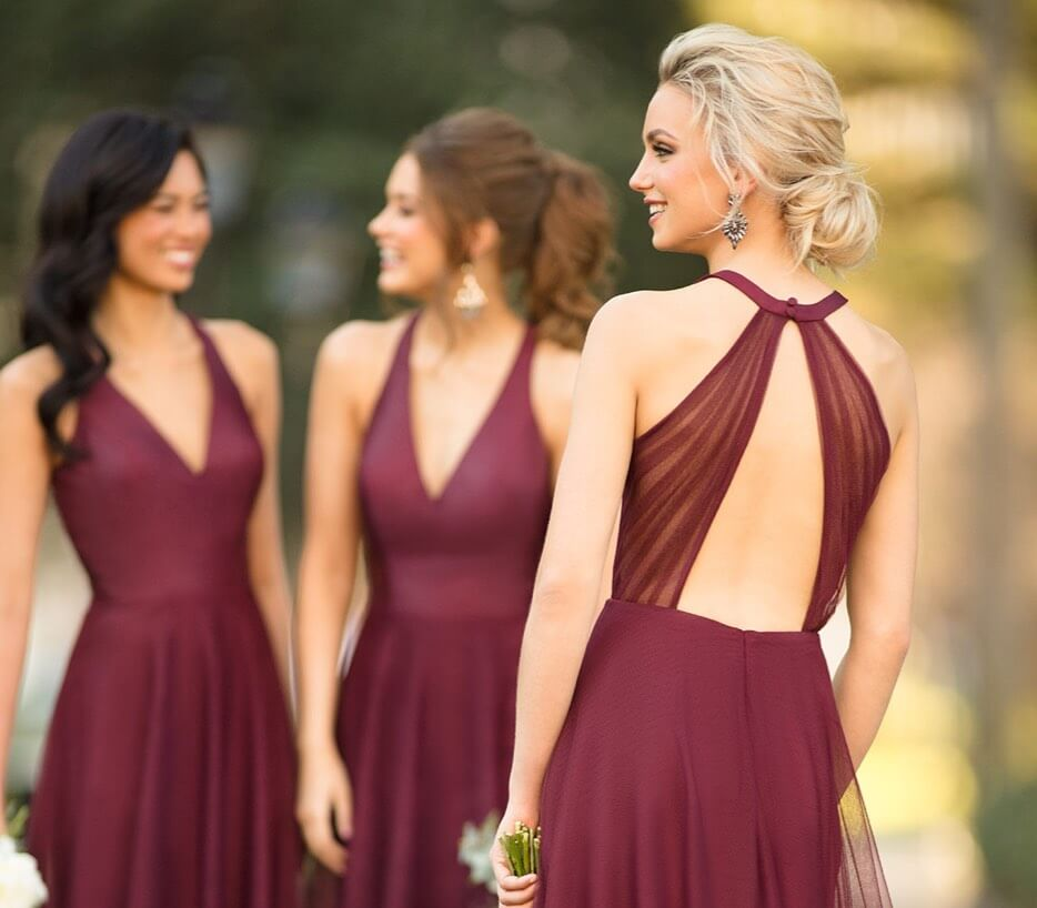 Bridesmaids wearing bordeaux dresses